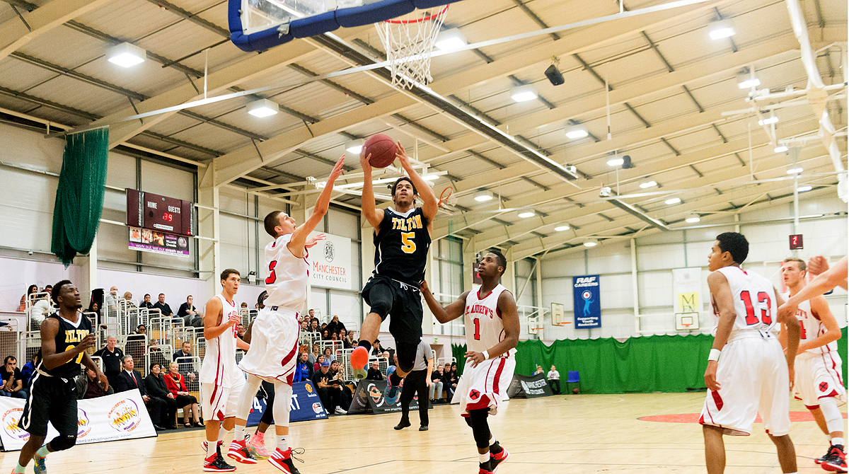 Tilton #5 Franklin Porter takes it strong to the rack.  Photo by Jack Hinds Photography.